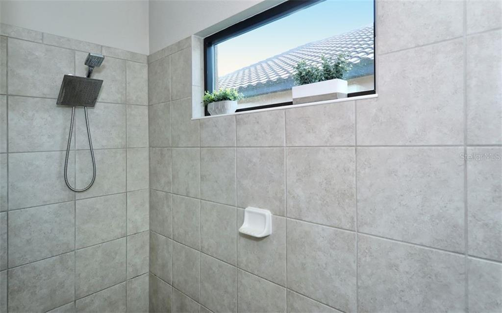 Master Roman shower - Single Family Home for sale at 221 Alfero Way, Nokomis, FL 34275 - MLS Number is N6102041