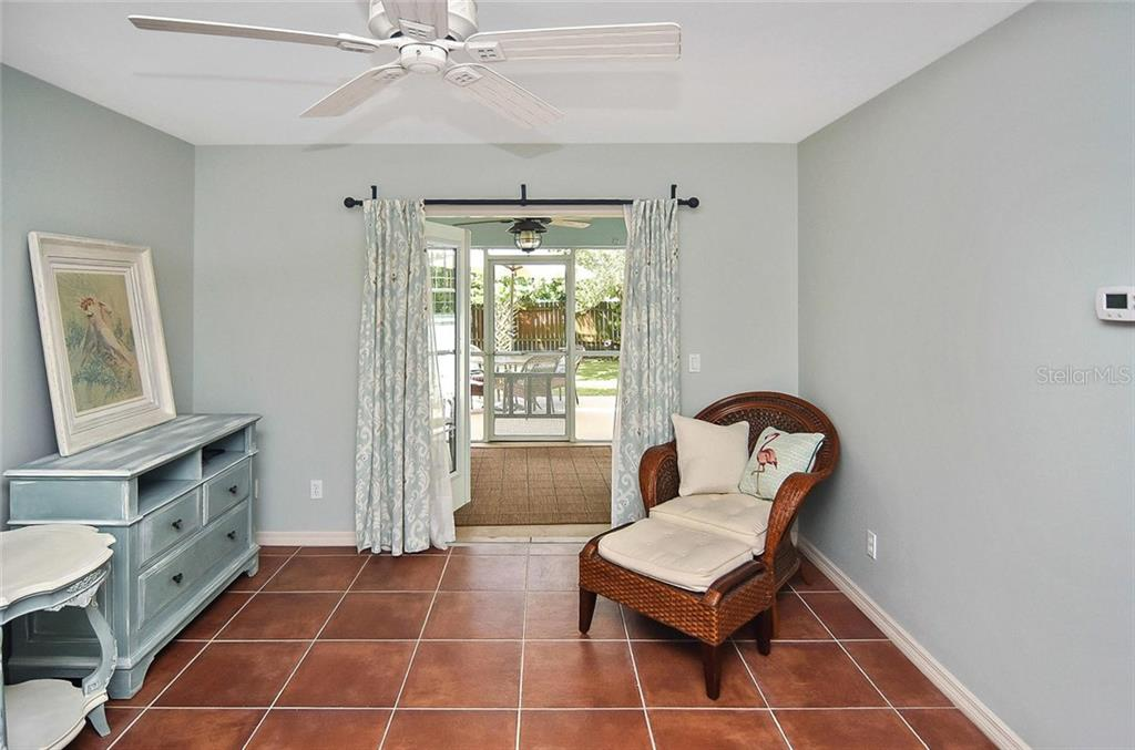 Master Bedroom with French doors to screened lanai - Single Family Home for sale at 316 Alba St E, Venice, FL 34285 - MLS Number is N6102095