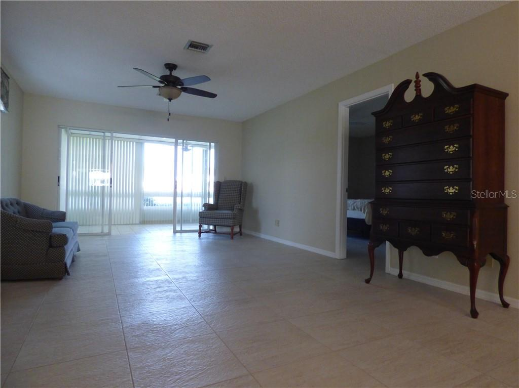 Dining Room with beautifully remodeled flooring. - Villa for sale at 206 Cerromar Way S #25, Venice, FL 34293 - MLS Number is N6102127