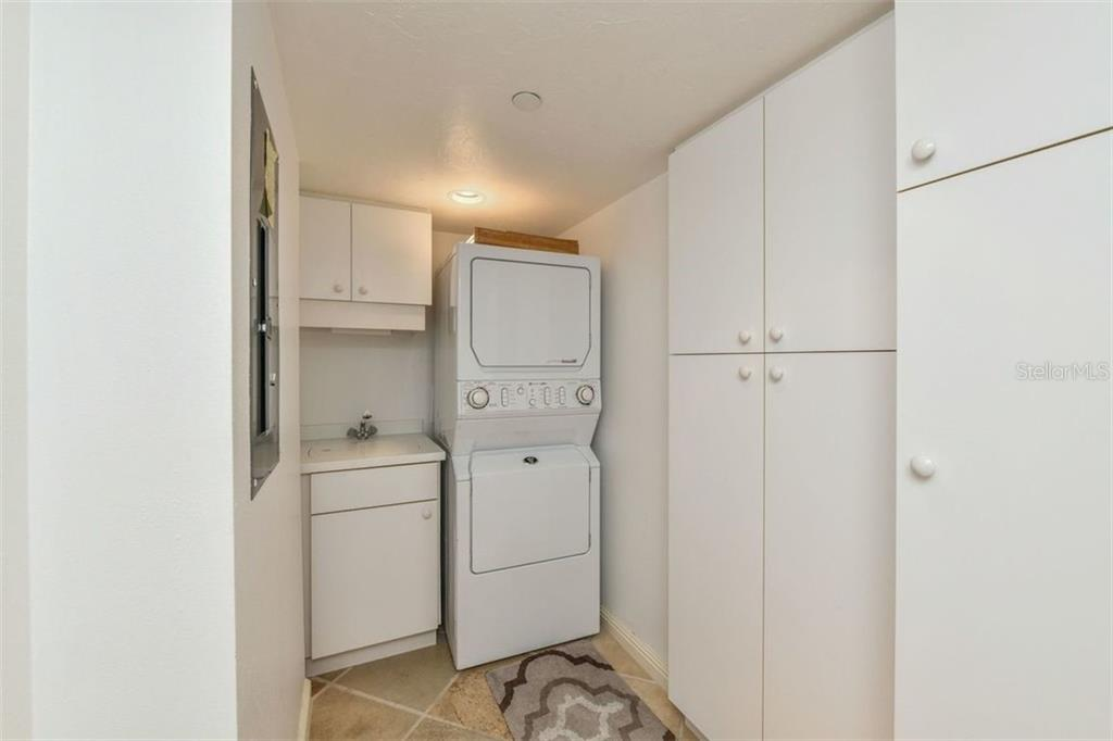 LAUNDRY ROOM WITH STORAGE - Condo for sale at 5740 Midnight Pass Rd #505 F, Sarasota, FL 34242 - MLS Number is N6102195
