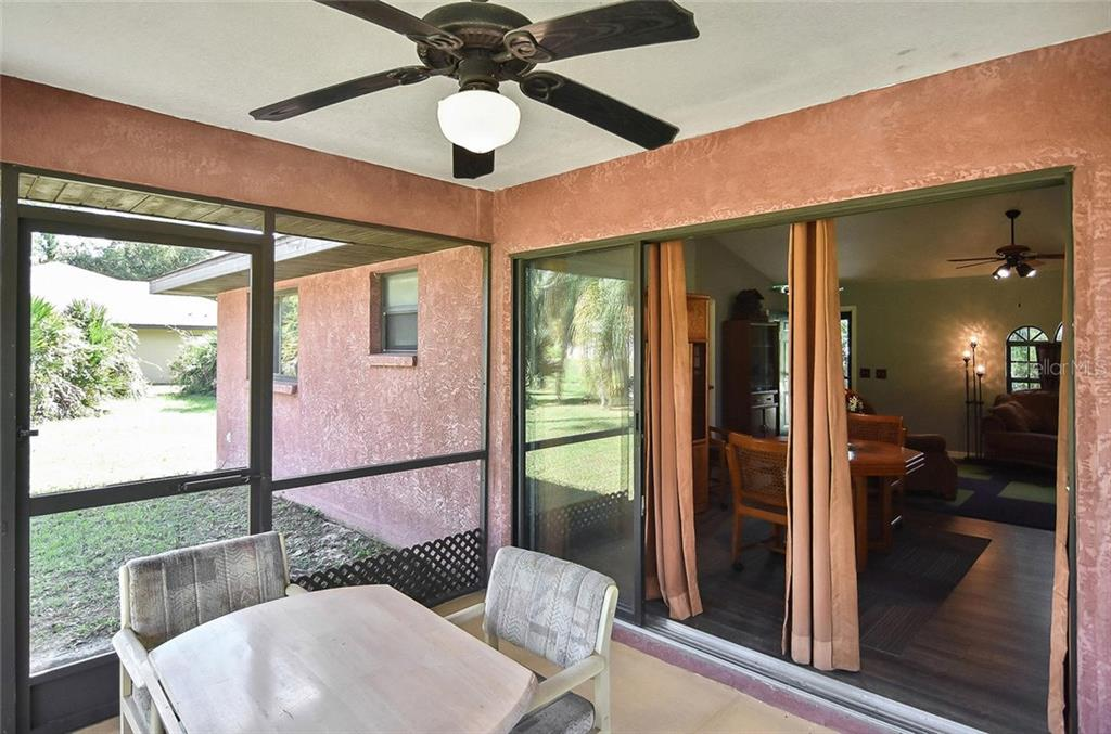 Lanai to dining room - Single Family Home for sale at 3572 January Ave, North Port, FL 34288 - MLS Number is N6102434