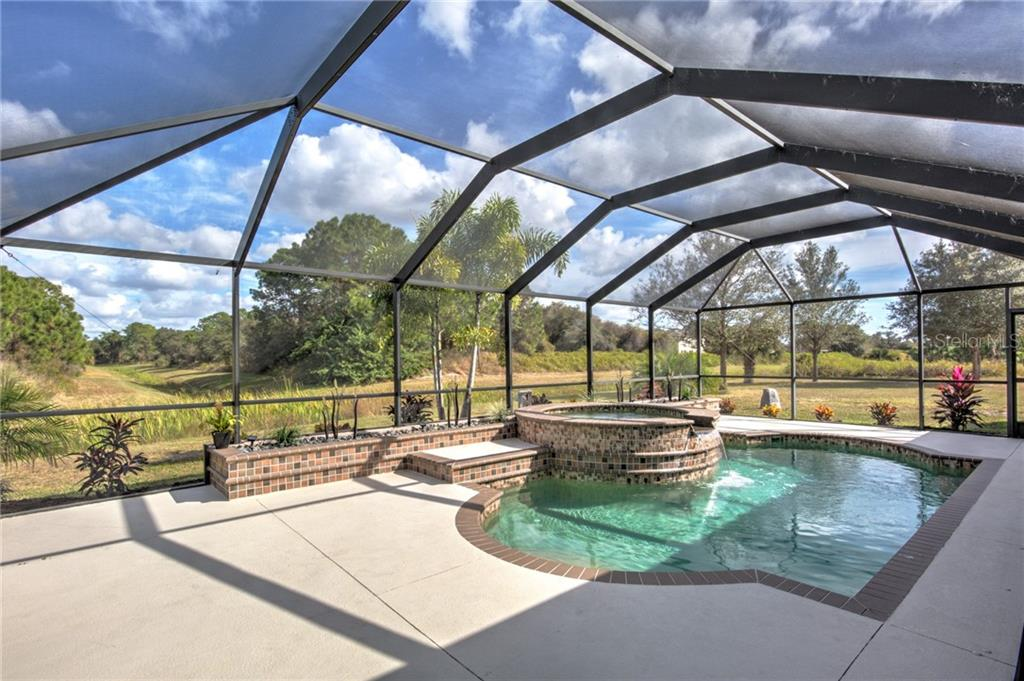Beautiful new landscape around pool - Single Family Home for sale at 6612 Deer Run Rd, North Port, FL 34291 - MLS Number is N6103231