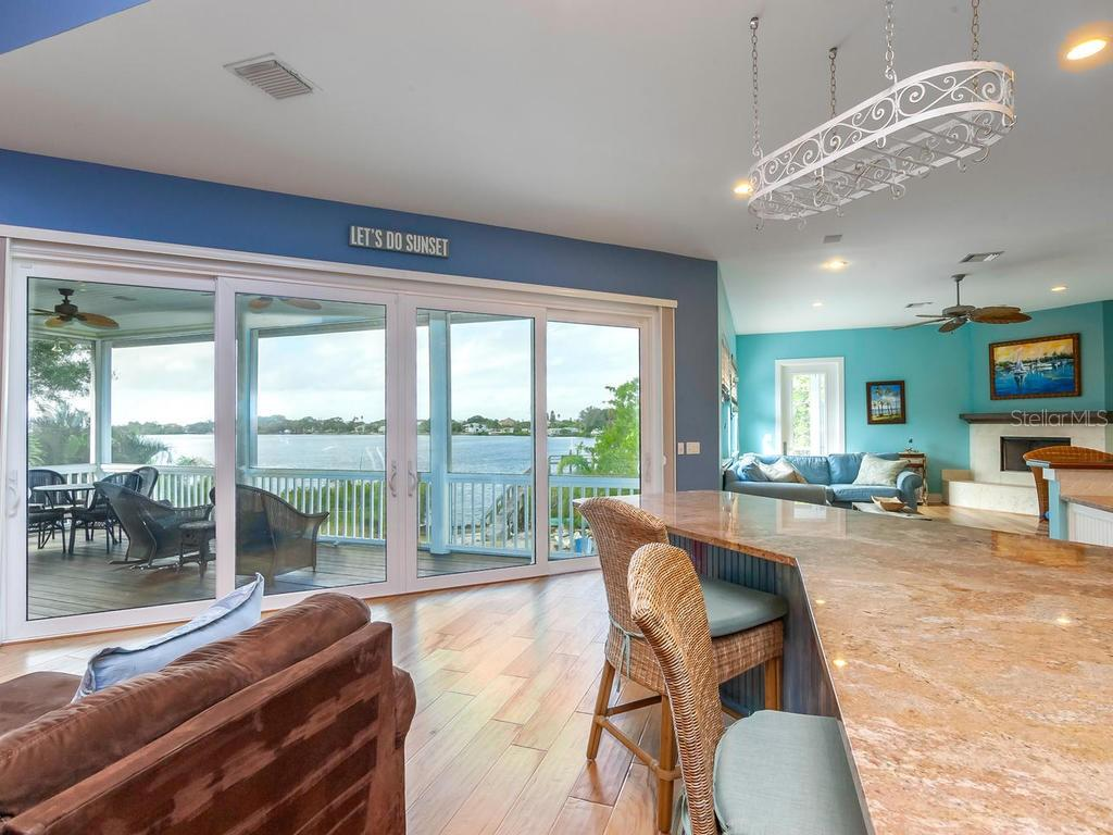 Great room, breakfast bar with view of Roberts Bay - Single Family Home for sale at 735 Eagle Point Dr, Venice, FL 34285 - MLS Number is N6103576