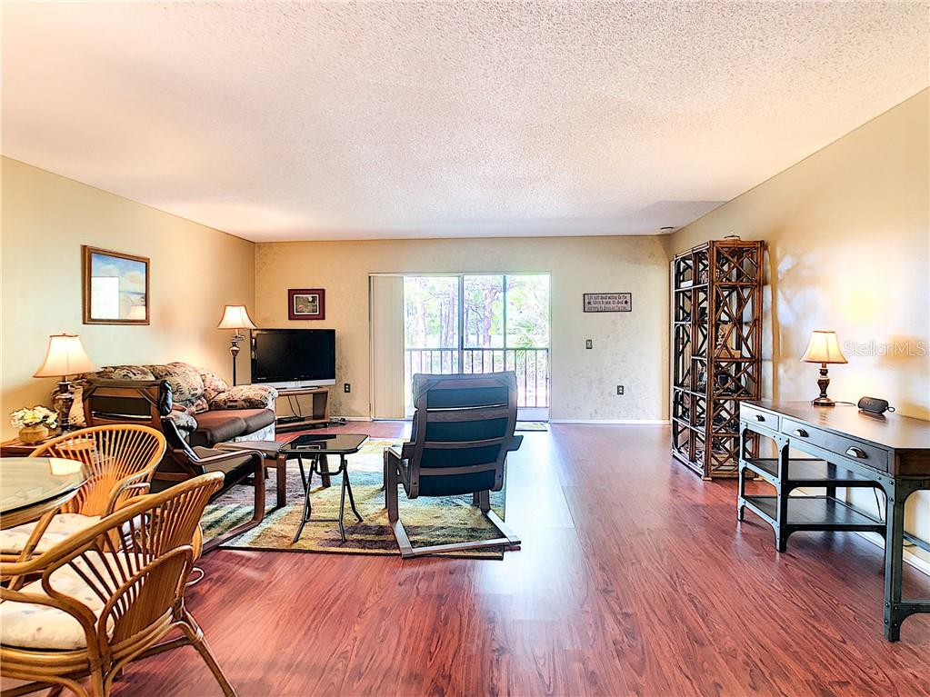 Spacious great room with room for dining, living and a desk - Condo for sale at 211 Rubens Dr #h, Nokomis, FL 34275 - MLS Number is N6103629