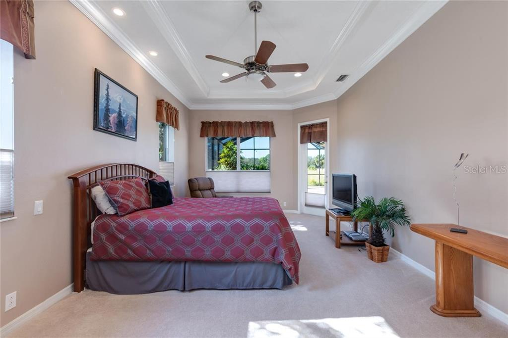 Master suite with sitting area, tray ceiling and door to lanai. - Single Family Home for sale at 821 Adonis Pl, Venice, FL 34292 - MLS Number is N6104303