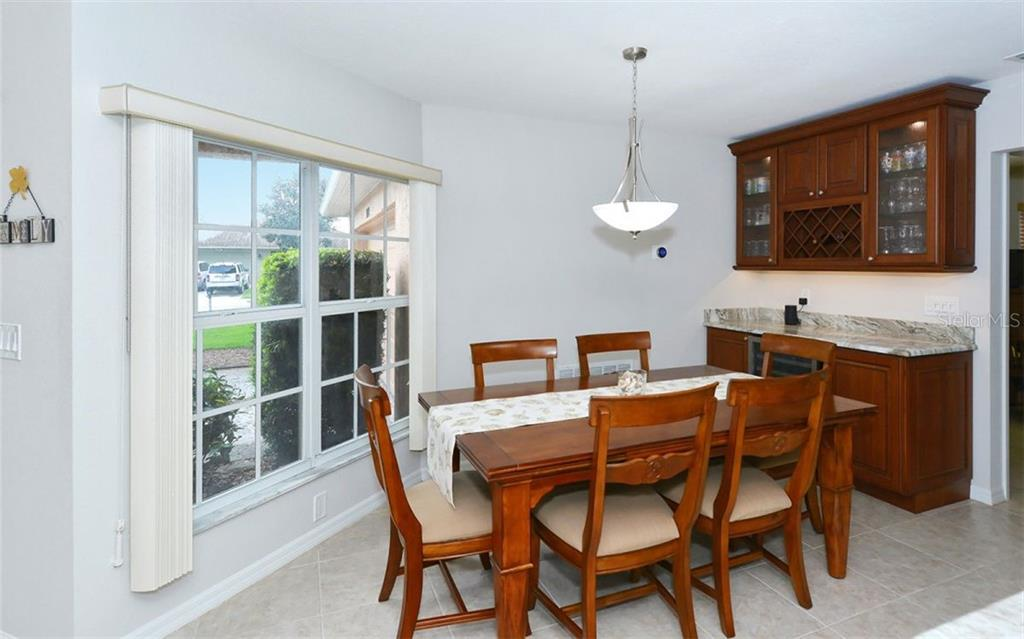 Dining room - Single Family Home for sale at 1460 Strada D Argento, Venice, FL 34292 - MLS Number is N6104612