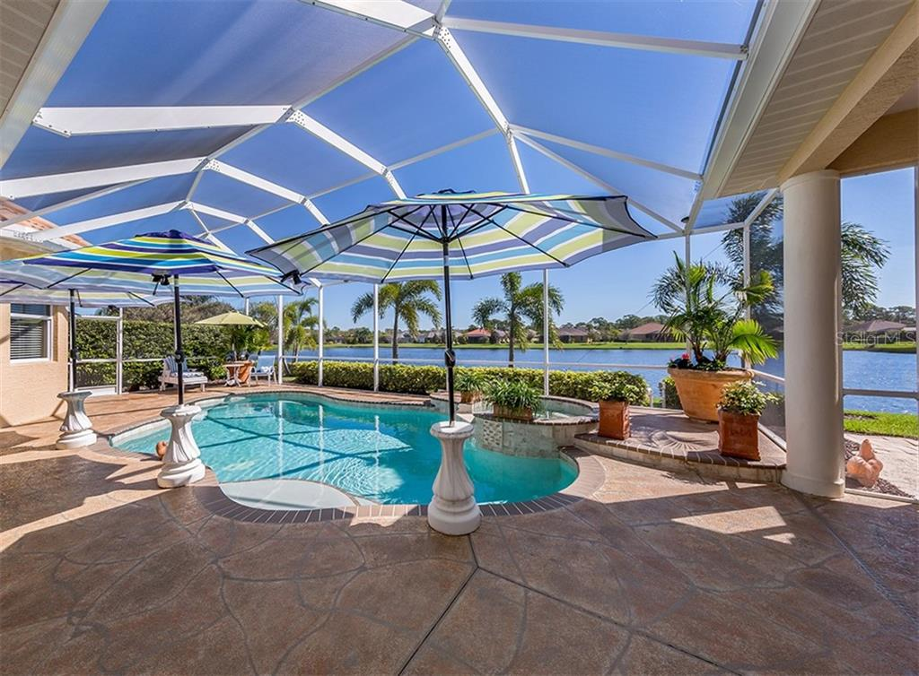 Pool with lake view - Single Family Home for sale at 19799 Cobblestone Cir, Venice, FL 34292 - MLS Number is N6104694