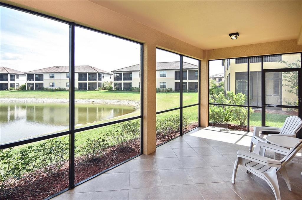 Beautiful lake view from the oversized tiled lanai. - Condo for sale at 20111 Ragazza Cir #102, Venice, FL 34293 - MLS Number is N6105517