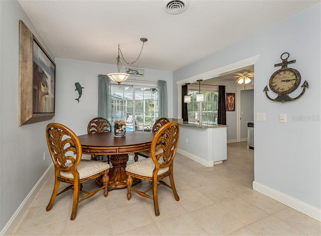 Dining room - Single Family Home for sale at 409 Darling Dr, Venice, FL 34285 - MLS Number is N6105760