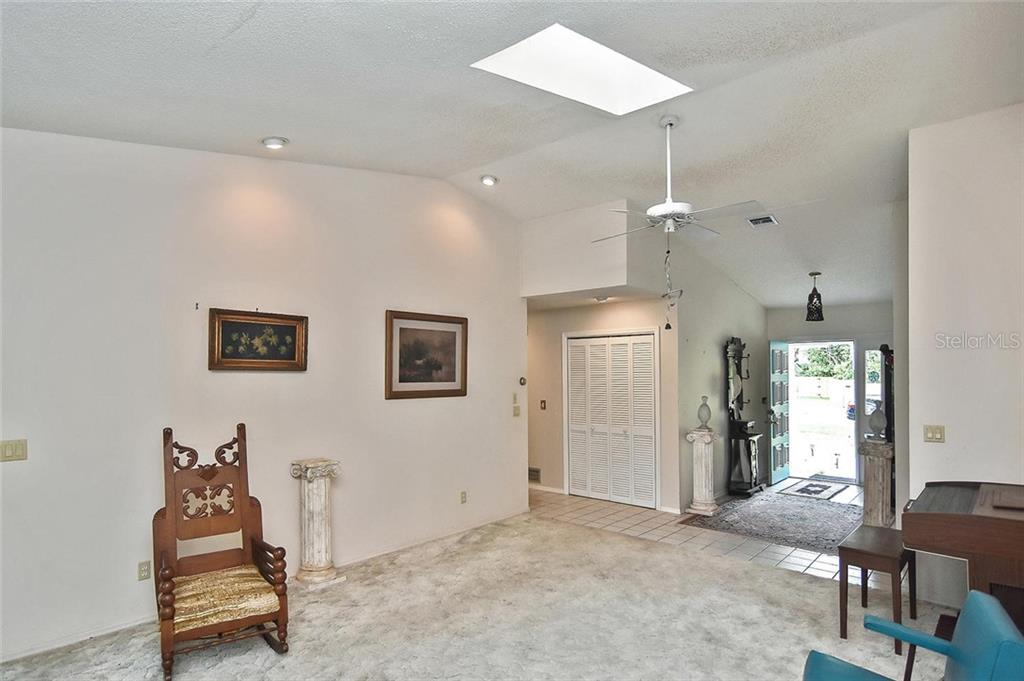 Living room to foyer - Single Family Home for sale at 125 Palm Ave E, Nokomis, FL 34275 - MLS Number is N6105973