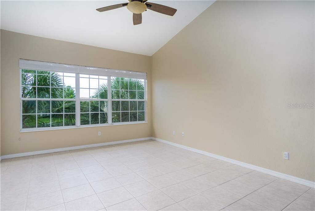 Lake View from Living Room - Condo for sale at 1910 Triano Cir #1910, Venice, FL 34292 - MLS Number is N6106332