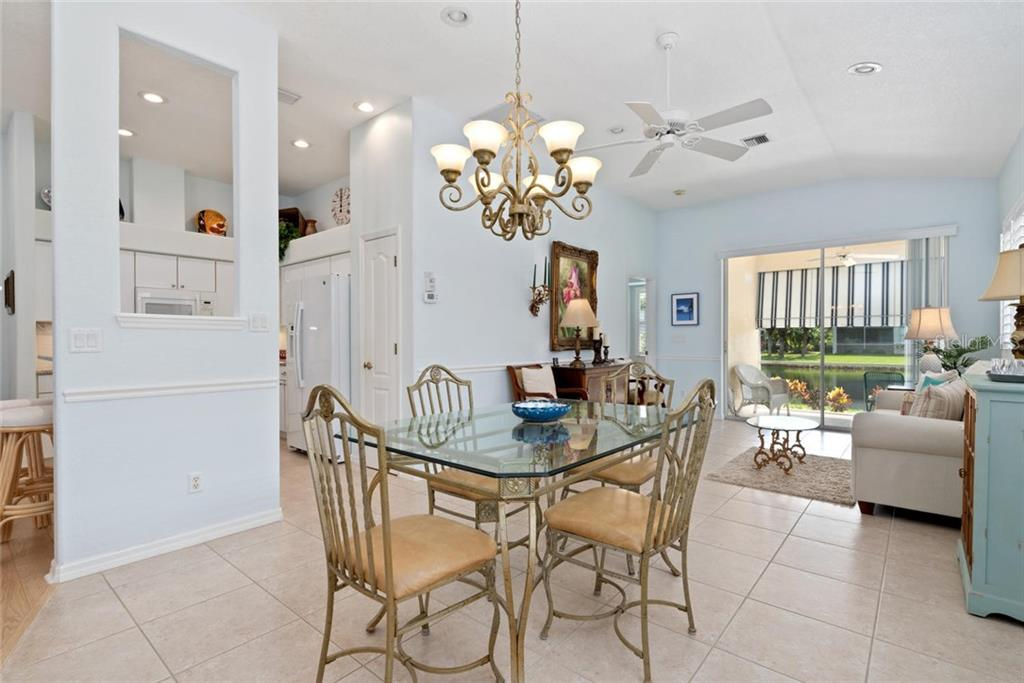 Dining room, living room to kitchen - Villa for sale at 1708 Fountain View Cir, Venice, FL 34292 - MLS Number is N6106422
