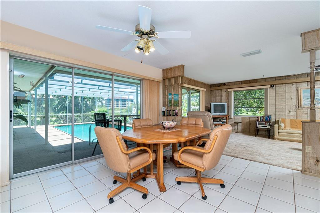 Eat in Kitchen area adjacent to family room - Single Family Home for sale at 359 Renoir Dr, Osprey, FL 34229 - MLS Number is N6106429