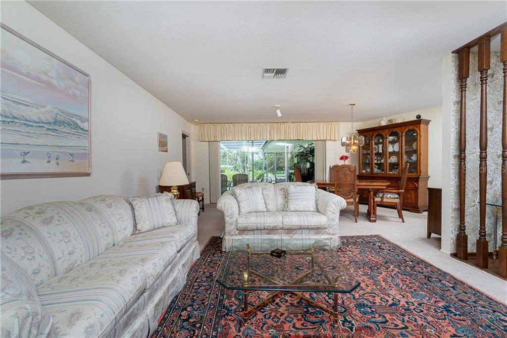 Living/Dining combination - Single Family Home for sale at 359 Renoir Dr, Osprey, FL 34229 - MLS Number is N6106429