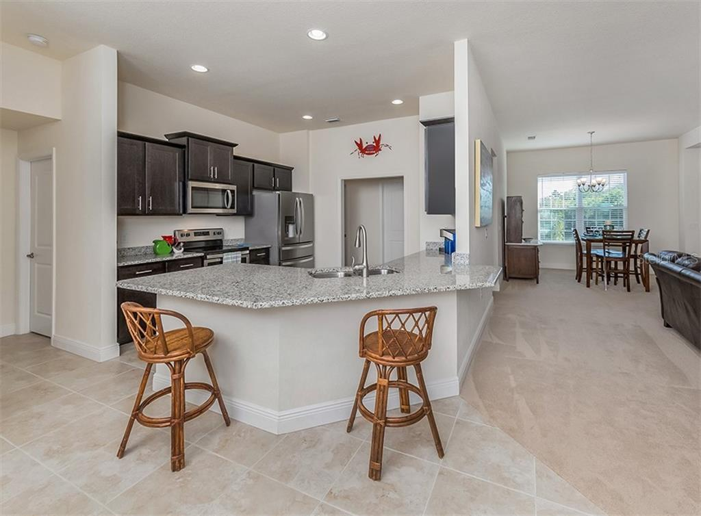 Breakfast bar - Single Family Home for sale at 10449 Redondo St, Port Charlotte, FL 33981 - MLS Number is N6107406