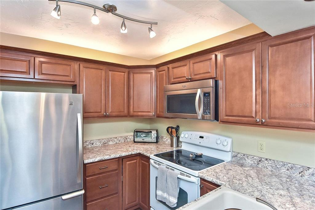 Kitchen - Condo for sale at 626 Bird Bay Dr S #104, Venice, FL 34285 - MLS Number is N6107935