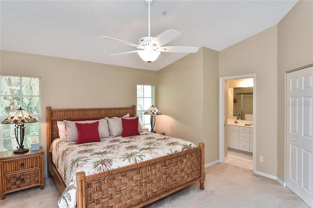 Master bedroom with sliders to family room - Condo for sale at 817 Montrose Dr #201, Venice, FL 34293 - MLS Number is N6107943
