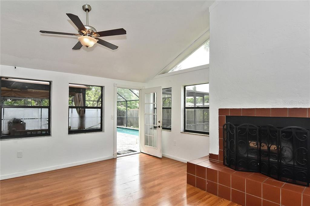 Family room with door to pool - Single Family Home for sale at 615 Lehigh Rd, Venice, FL 34293 - MLS Number is N6108175