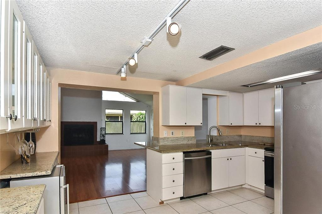 Kitchen to family room - Single Family Home for sale at 615 Lehigh Rd, Venice, FL 34293 - MLS Number is N6108175