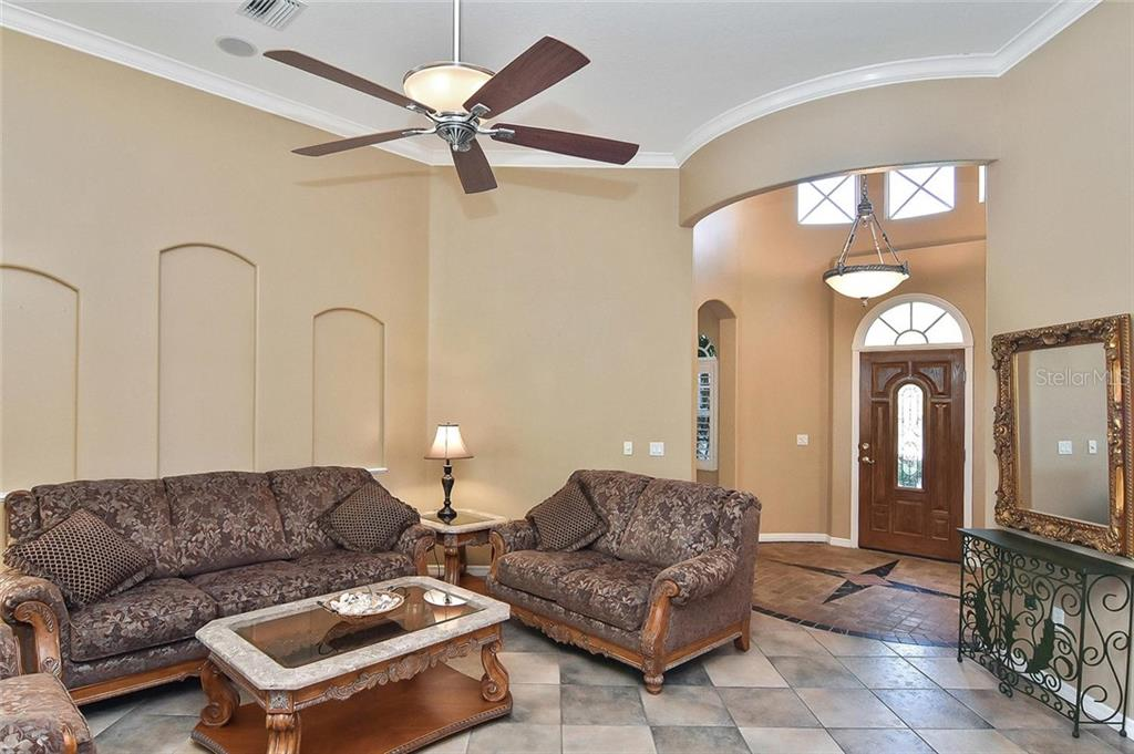 Living room, foyer - Single Family Home for sale at 321 Dulmer Dr, Nokomis, FL 34275 - MLS Number is N6108685