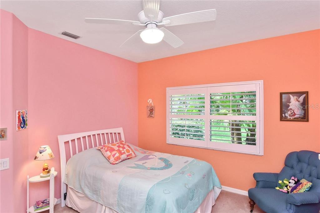 Bedroom 3 - Single Family Home for sale at 7185 N Serenoa Dr, Sarasota, FL 34241 - MLS Number is N6109058