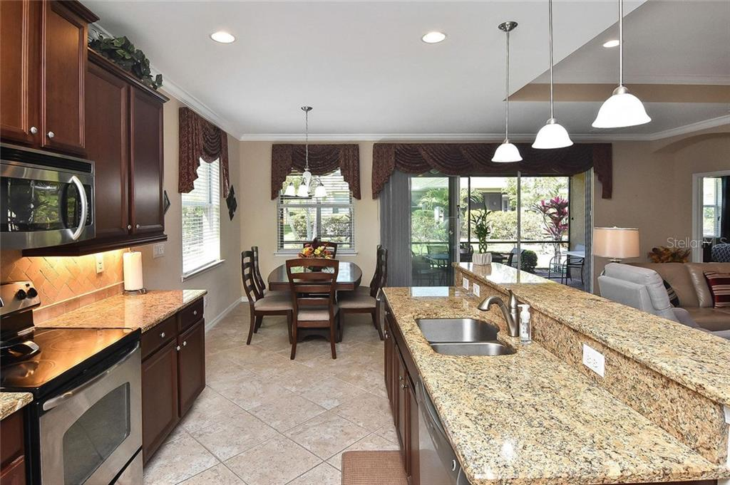 Kitchen to dining room - Single Family Home for sale at 5093 Layton Dr, Venice, FL 34293 - MLS Number is N6109788