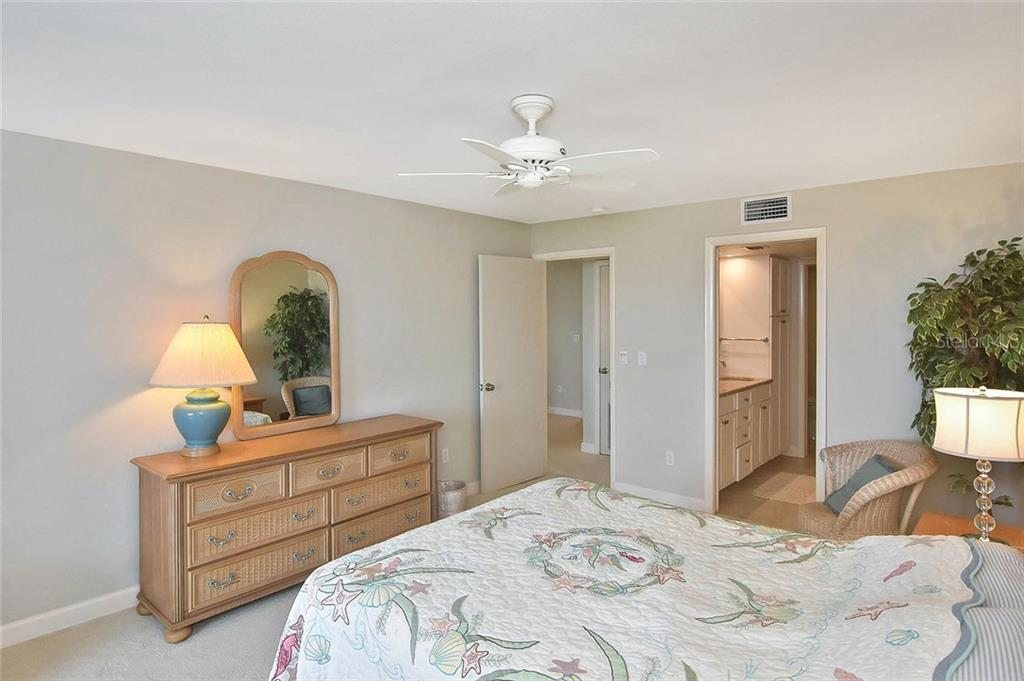 Master bedroom to master bathroom - Condo for sale at 862 Golden Beach Blvd #862, Venice, FL 34285 - MLS Number is N6110157