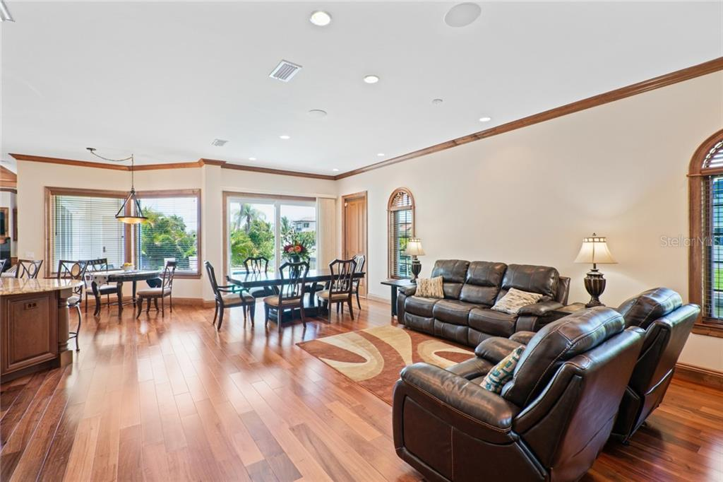 Family Room & Dining Areas - Single Family Home for sale at 510 Bowsprit Ln, Longboat Key, FL 34228 - MLS Number is N6110334