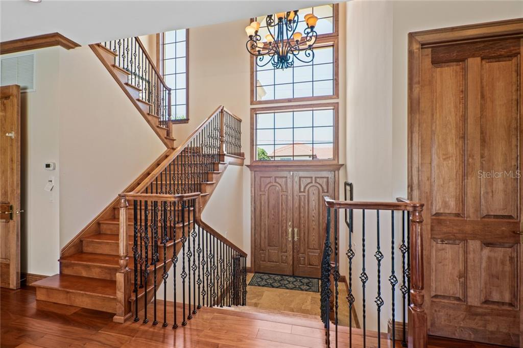 20+ foot entry with Chandelier, tons of hardwood. elevator to the left from garage to 1st & 2nd floor - Single Family Home for sale at 510 Bowsprit Ln, Longboat Key, FL 34228 - MLS Number is N6110334