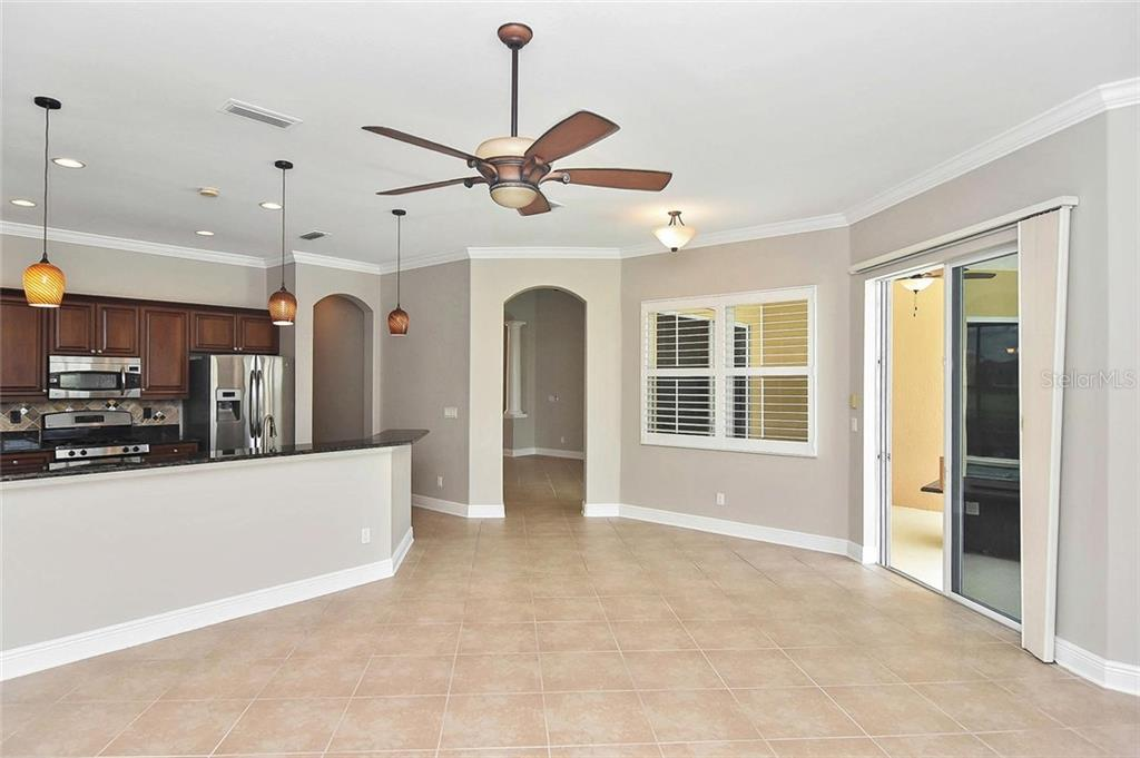 Family room, kitchen - Single Family Home for sale at 193 Medici Ter, North Venice, FL 34275 - MLS Number is N6110365