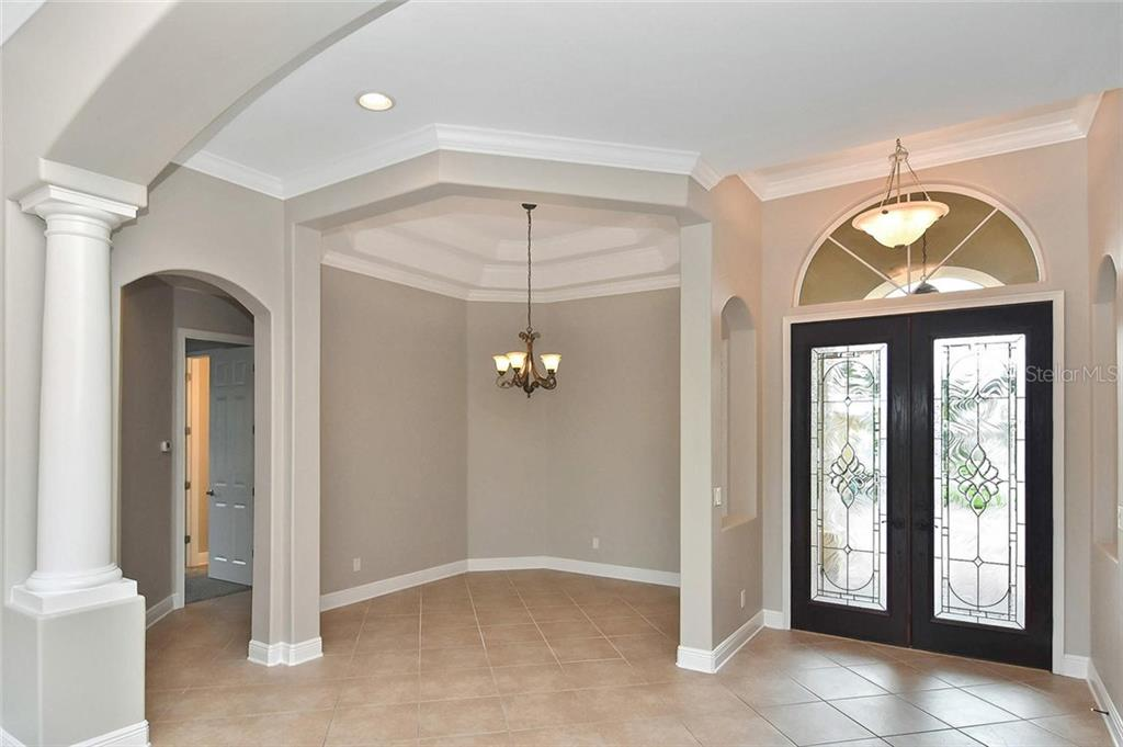 Dining room, foyer - Single Family Home for sale at 193 Medici Ter, North Venice, FL 34275 - MLS Number is N6110365