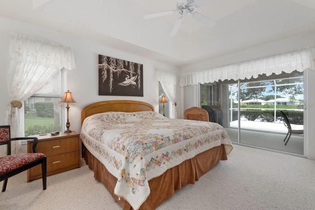 Owner's suite with sliders to lanai - Single Family Home for sale at 498 Pine Lily Way, Venice, FL 34293 - MLS Number is N6110849