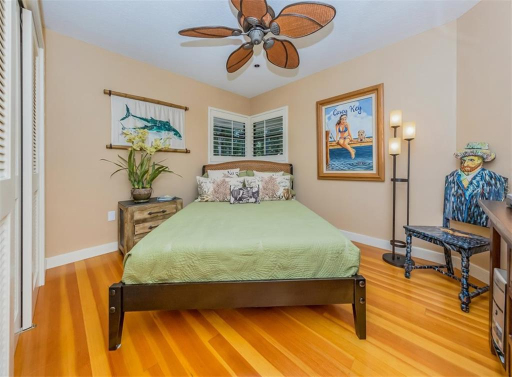 Main house bedroom 3 - Single Family Home for sale at 2208 Casey Key Rd, Nokomis, FL 34275 - MLS Number is N6110959