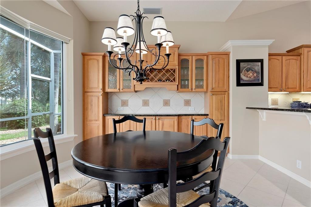 Breakfast room/dinette - Single Family Home for sale at 953 Chickadee Dr, Venice, FL 34285 - MLS Number is N6111180