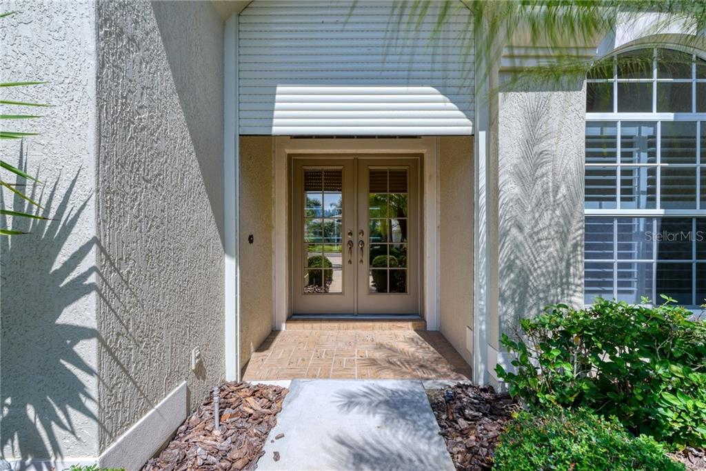 Front entry has electronic hurricane protection - Single Family Home for sale at 953 Chickadee Dr, Venice, FL 34285 - MLS Number is N6111180