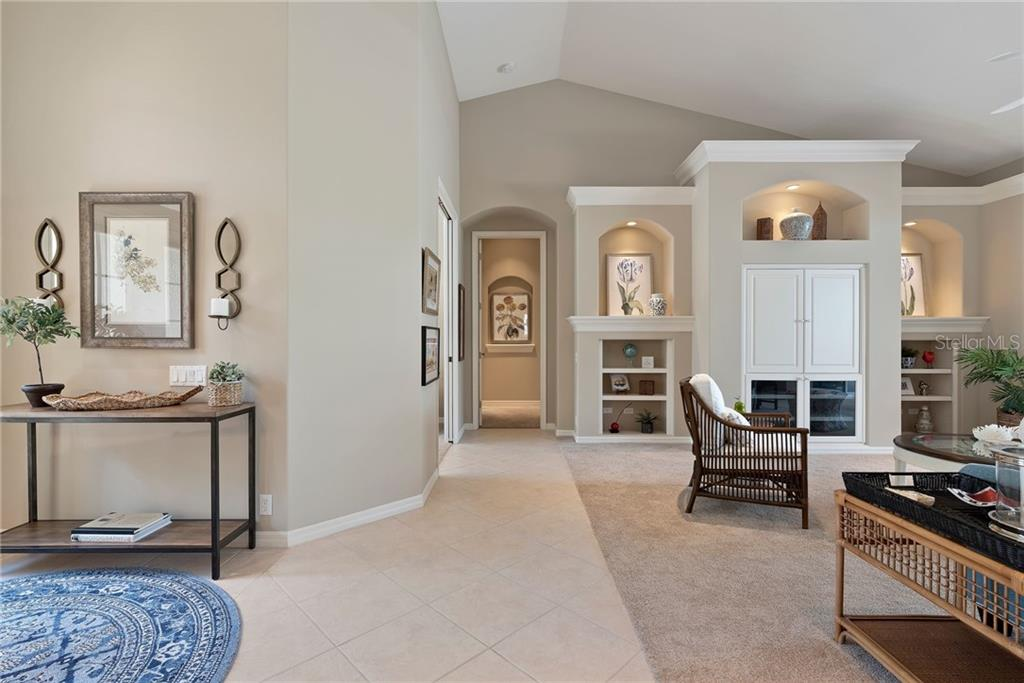 Great room from foyer - Single Family Home for sale at 953 Chickadee Dr, Venice, FL 34285 - MLS Number is N6111180