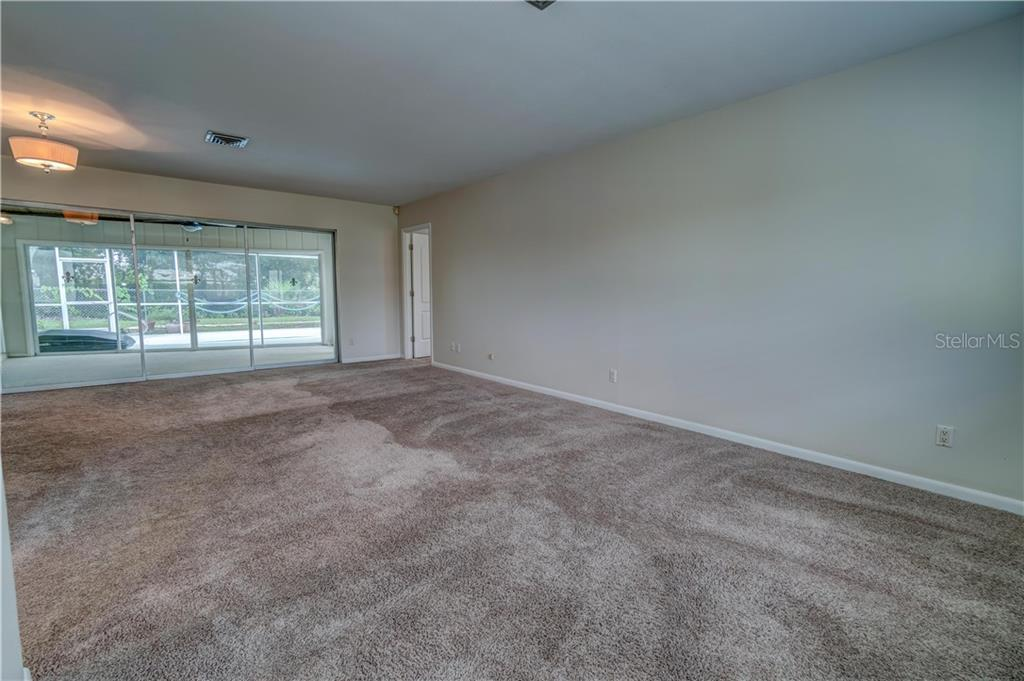Living Room - Single Family Home for sale at 158 Golf Club Ln, Venice, FL 34293 - MLS Number is N6111200