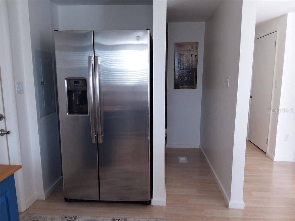 The access next to the refrigerator leads to a pantry that is very large.  No need to go to Publix daily with this house. - Single Family Home for sale at 707 S Green Cir #71, Venice, FL 34285 - MLS Number is N6111316