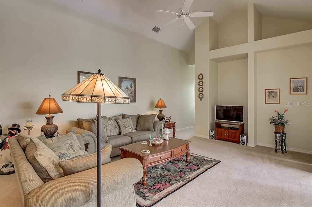 Family room - Single Family Home for sale at 1031 Scherer Way, Osprey, FL 34229 - MLS Number is N6111839