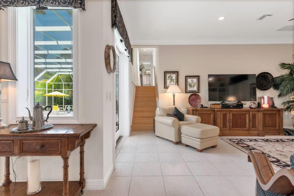 Stairway to 2nd floor, family room - Single Family Home for sale at 725 Eagle Point Dr, Venice, FL 34285 - MLS Number is N6111842