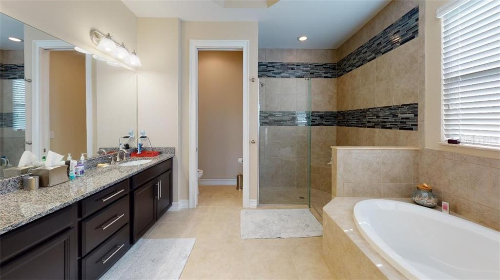 MASTER BATHROOM - Single Family Home for sale at 1051 Bradberry Dr, Nokomis, FL 34275 - MLS Number is N6112687