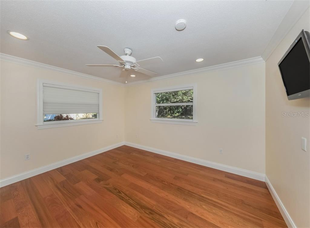 Bedroom 2 - Single Family Home for sale at 1321 Guilford Dr, Venice, FL 34292 - MLS Number is N6113272