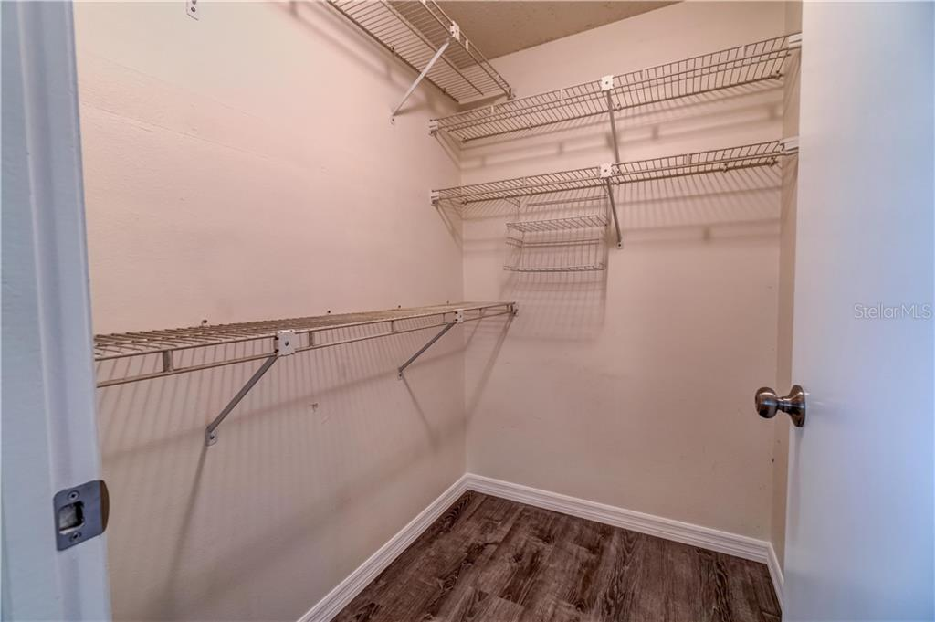 Middle bedroom walk in closet - Single Family Home for sale at 607 Garden Rd, Venice, FL 34293 - MLS Number is N6113347