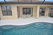 Pool/lanai - Single Family Home for sale at 1975 Batello Dr, Venice, FL 34292 - MLS Number is N5911919