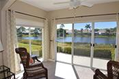 Lanai with lake view - Condo for sale at 903 Addington Ct #102, Venice, FL 34293 - MLS Number is N5916962