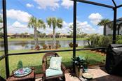 Extended screened lanai with lake views - Single Family Home for sale at 13880 Lido St, Venice, FL 34293 - MLS Number is N5917319
