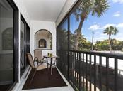 Private screened balcony on the east side of the unit. Both bedrooms have sliding doors leading to the balcony - enjoy a sunrise with your morning coffee! - Condo for sale at 500 Park Blvd S #67, Venice, FL 34285 - MLS Number is N6100360