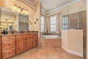 Master bath view 2 - Single Family Home for sale at 20145 Cristoforo Pl, Venice, FL 34293 - MLS Number is N6100537