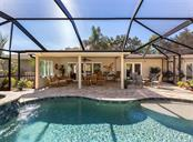 Heated pool and spa (2016) overlooking the covered lanai - Single Family Home for sale at 612 Armada Rd N, Venice, FL 34285 - MLS Number is N6102546