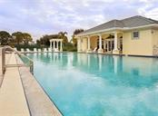 Community pool, clubhouse - Single Family Home for sale at 627 Lakescene Dr, Venice, FL 34293 - MLS Number is N6103268
